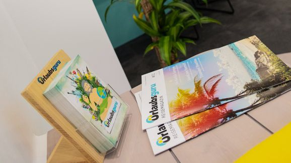 Colourful brochures and palm-trees get customers in the mood to book.