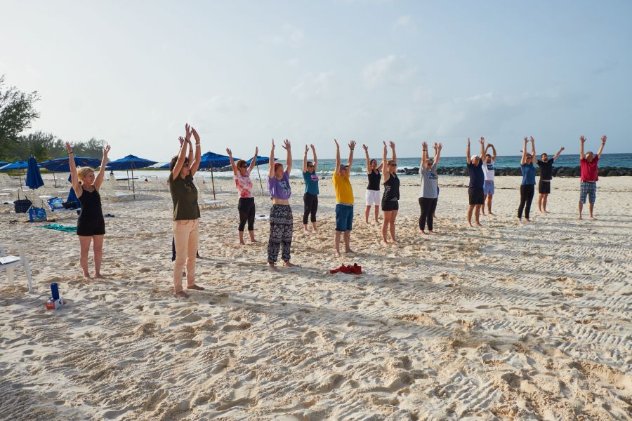Early morning yoga on the beach of the Hilton Resort