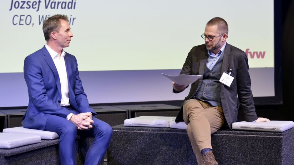 Wizz Air chief Jozsef Varadi (left) is interviewed by moderator Jens Flottau.