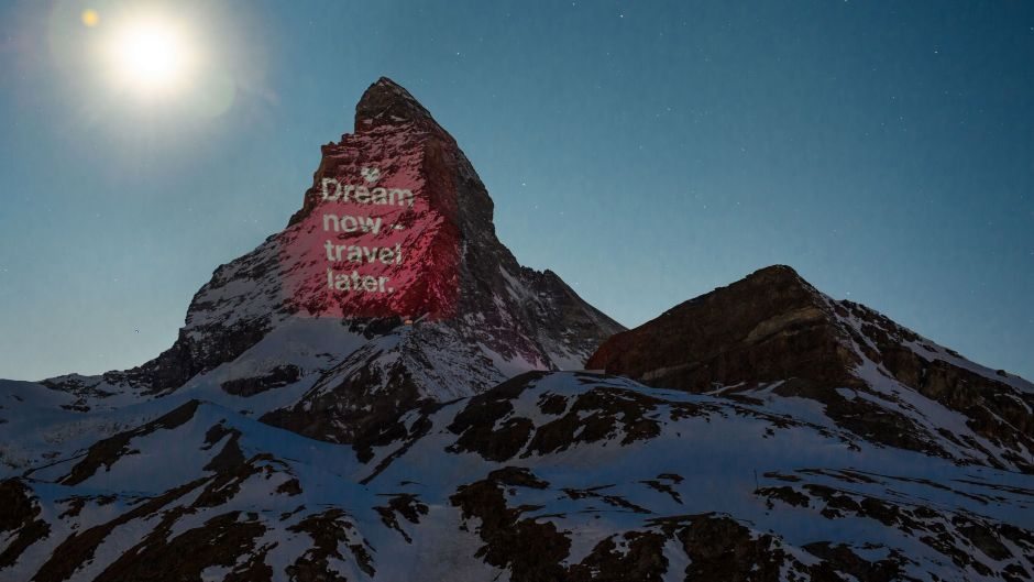"""Dream now - travel later"": a light installation on the Matterhorn in Switzerland."
