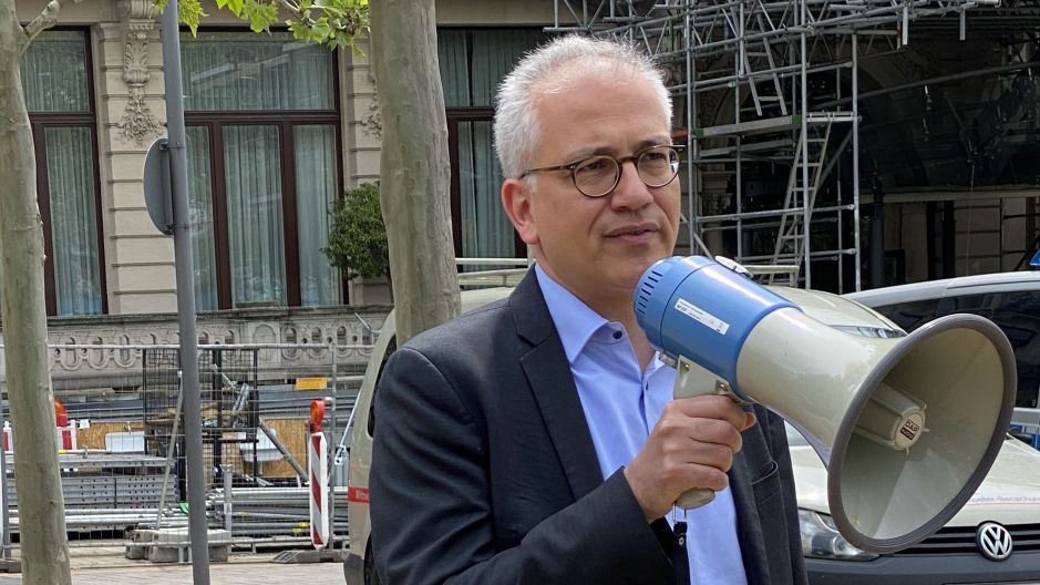 Political reaction: Tarek al Wazir, minister for economic affairs in Hesse, speaking to protesters in Wiesbaden.