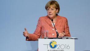 Angela Merkel addresses the German Tourism Summit in Berlin.