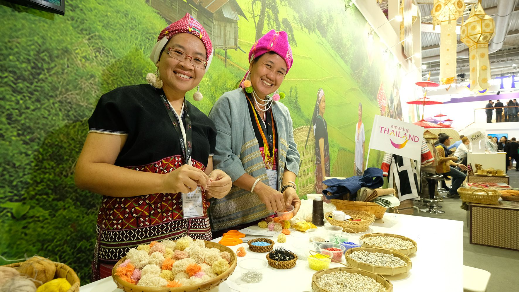 All smiles on the Thai stand at ITB.