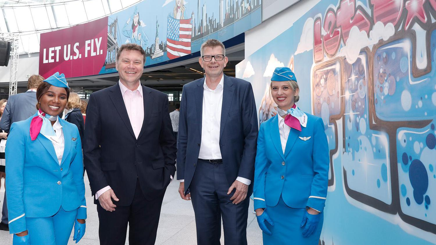 Düsseldorf Airport chief Thomas Schnalke (left) and Eurowings CEO Thorsten Dirks celebrate the New York flights