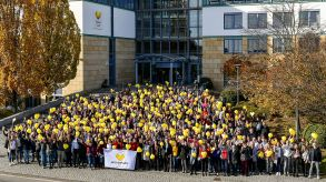 A heartfelt goodbye. Thomas Cook Germany staff wave farewell in front of the company's head office in Oberursel, near Frankfurt.