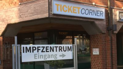 "Ticket to ride? EU officials discuss a standardized vaccination certificate. The picture shows the signage of a vaccination centre (""Impfzentrum"") in Norther Germany."